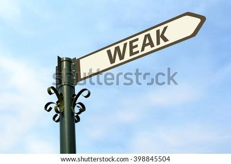 WEAK WORD ON ROADSIGN - stock photo