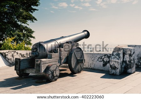 Weapon at Guia Fortress lighthouse in Macau at day time. Filtered image. - stock photo