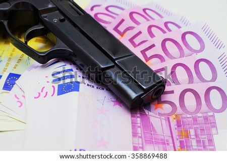 Weapon is on money - stock photo