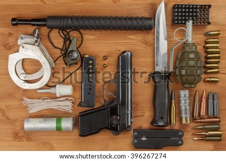 Weapons and Equipment secret agent. Preparing for a secret mission. Equipment terrorists. - stock photo