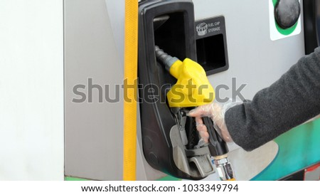 Wear antistatic gloves at gas station.