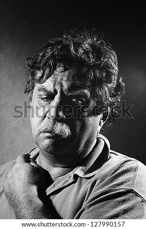weary middle-aged man, black and white