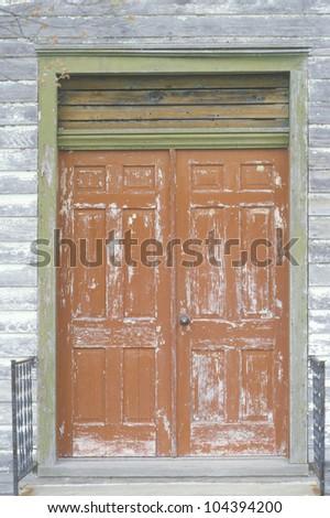 Weather beaten wooden doors, Eastern Shore, MD - stock photo