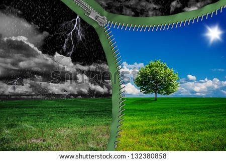Weather changes through the zipper. Storm and sunny - stock photo