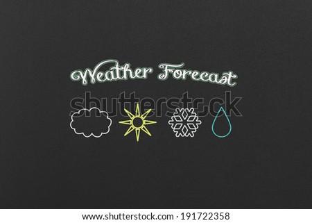Weather Forecast Symbols on a Black Chalkboard. - stock photo