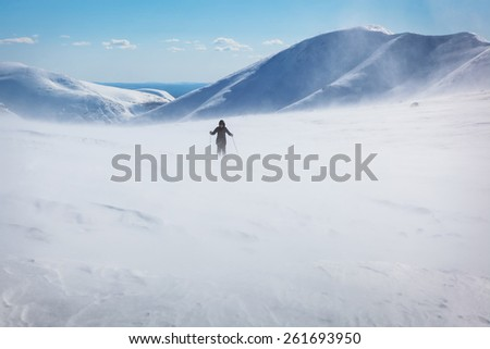 Weather in the hike. One person during a storm in the mountains of Hibihy, Murmansk region, Russia - stock photo