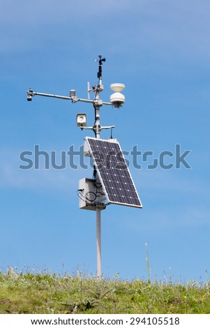 weather station against the blue sky. - stock photo