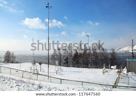 Weather station at the source of the Angara river, Siberia, Russia, the winter Baikal - stock photo