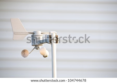 Weather Station measuring wind speed and direction. - stock photo