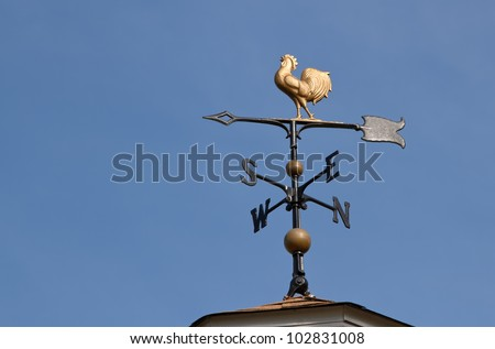 Weather vane  against a  blue sky - stock photo