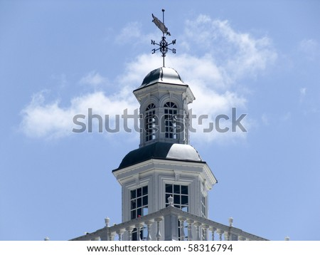 Weather vane on the top of a white building