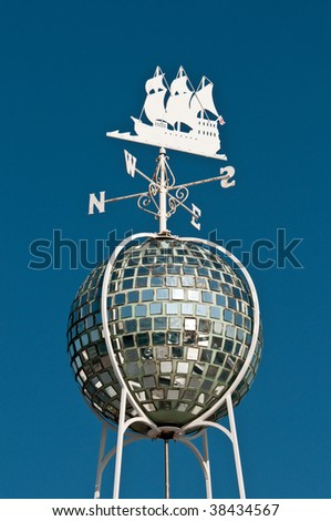 Weather Vane on top of mirror ball