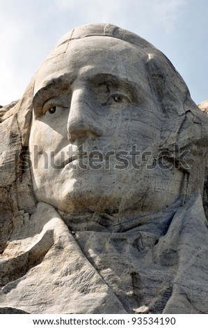weather worn face of GW - stock photo