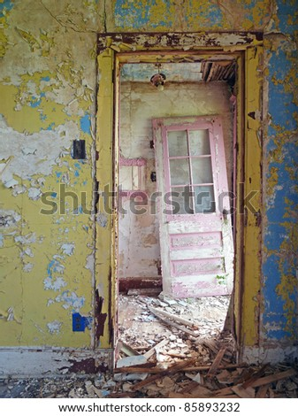 Weathered abandoned farmhouse doors and walls - stock photo