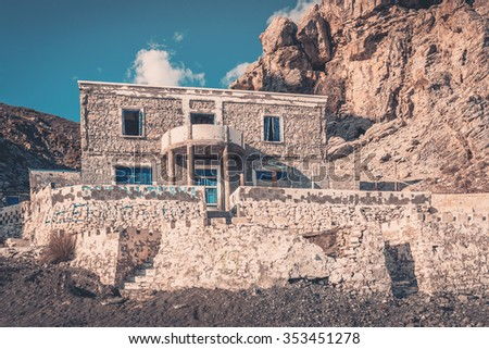 Weathered abandoned house on greek coastline on Kos island