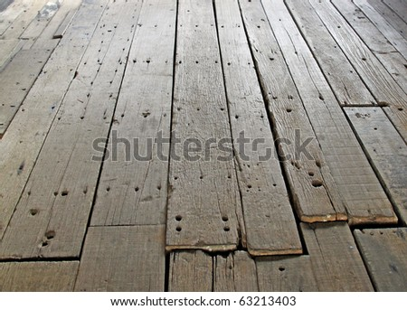 Weathered aged wooden plank flooring from a rural hut. - stock photo
