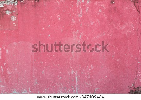 Weathered and aged red/pink concrete wall texture background. - stock photo
