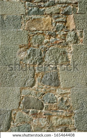 Weathered antique old cracked stone blocks wall retro background