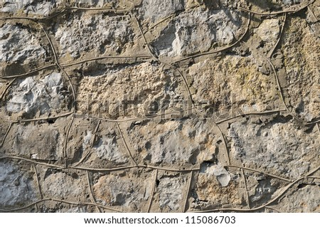 Weathered antique old cracked stone concrete wall retro background