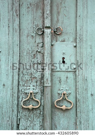 Weathered antique turquoise door with original lock and door knock. Portugal. - stock photo