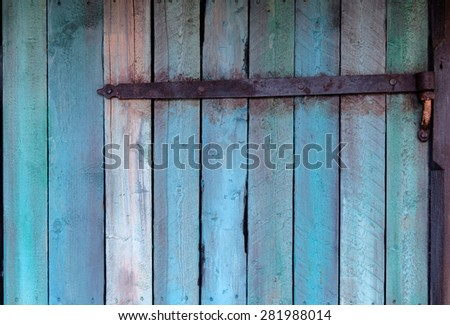 Weathered blue wall made of wood with a hinge - stock photo