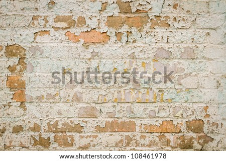 Weathered  brick wall with peeling paint - stock photo