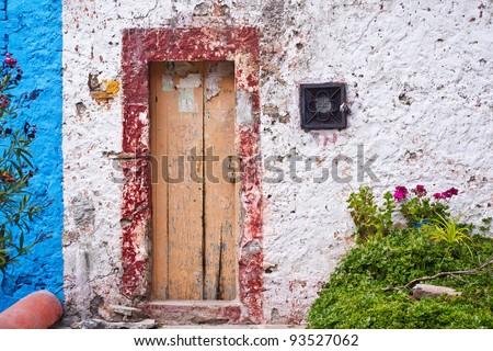 Weathered building in San Miguel de Allende, Mexico - stock photo