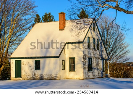 Weathered Cedar House in the fresh snow - stock photo