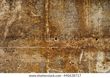weathered concrete surface with rusty iron elements