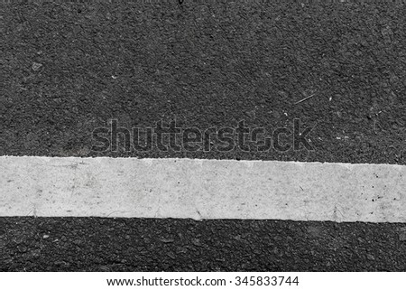 Weathered dirty old asphalt road textured for background design - stock photo