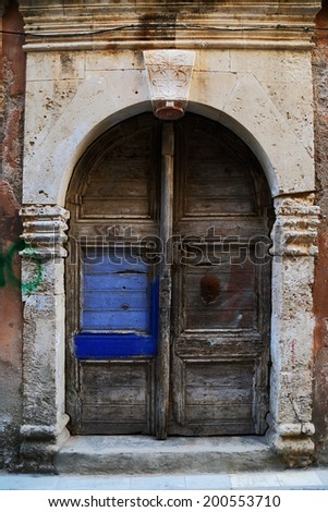Weathered door in the old town of Chania, Crete island - stock photo