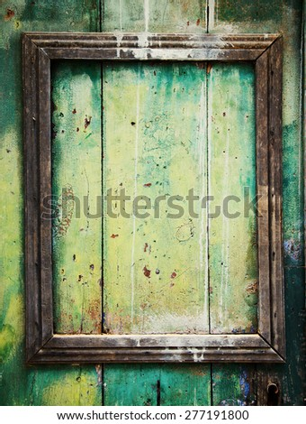 Weathered door with border frame. - stock photo