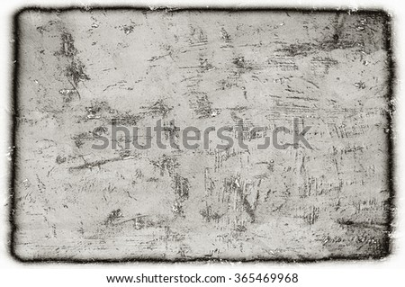 weathered dotted monochrome wall