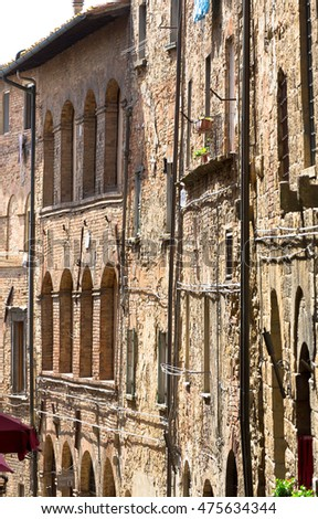 Weathered facades of residential houses in ancient town of Volterra, Tuscany, Italy