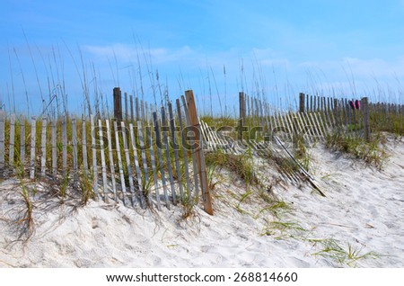 Weathered fence in the Florida beach sand dunes - stock photo