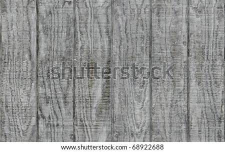 Weathered gray wooden barn siding using vertical planks - stock photo