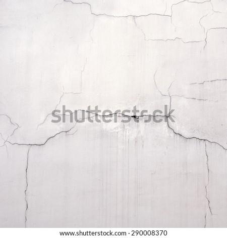 weathered grunge  cracked white stucco wall background - stock photo