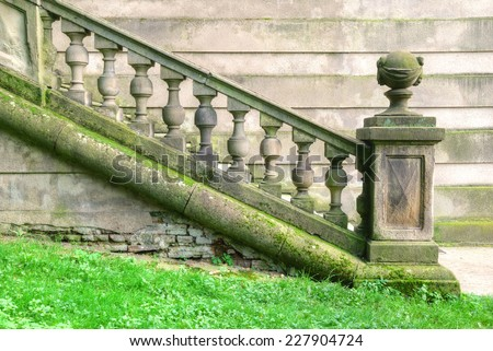 Weathered historic staircase with baroque balustrade - stock photo