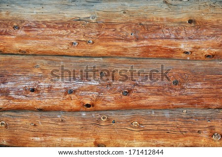 Weathered obsolete wooden logs with natural pattern background - stock photo