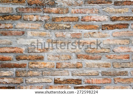 Weathered old brick wall texture as BAckground Pattern, grungy rusty brushed blocks as urban architecture backdrop. - stock photo