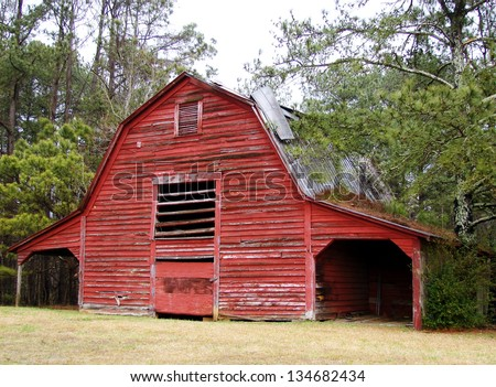 weathered old farm buildings red barn - stock photo