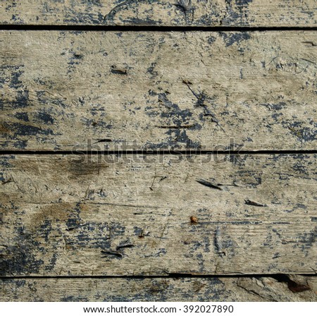 Weathered old wooden board with residual traces of paint