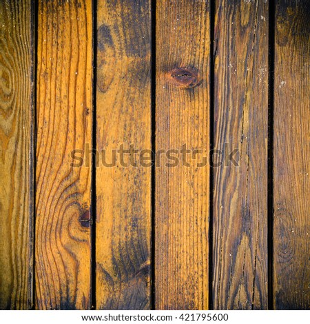 Weathered orange fir planks on wall, detailed background photo texture