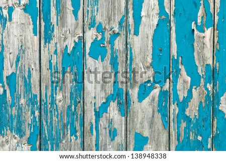 Weathered painted blue wood as a background - stock photo