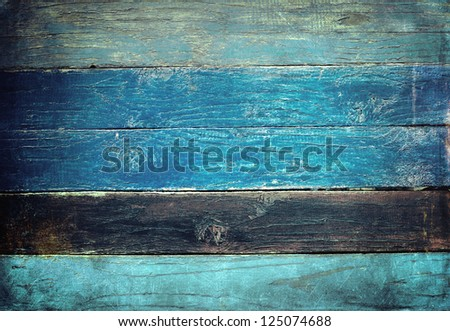 Weathered painted wooden boards background - stock photo