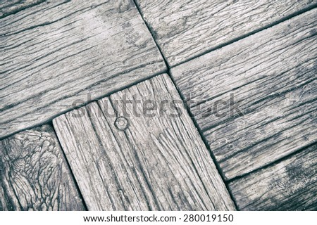Weathered rough wood plank background textured close-up with joints, grooves, and nails - stock photo