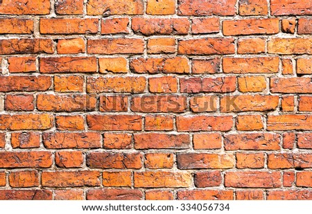 Weathered stained old brick wall as background - stock photo