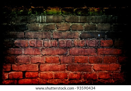 Weathered stained old brick wall with cracked and missing plaster - stock photo
