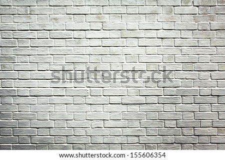 Weathered texture of stained old dark black and gray brick wall background, grungy rusty blocks of stone-work technology, colorful horizontal architecture - stock photo