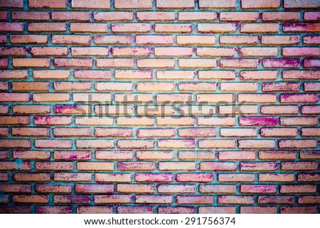 Weathered texture of stained old dark brown and red brick wall background, grungy rusty blocks of stone-work technology, colorful horizontal architecture - stock photo